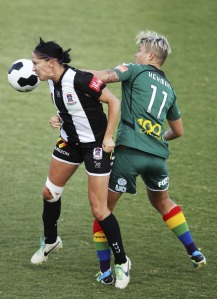 Battling Michelle Heyman of Australia for the ball in a W League match, Canberra v Newcastle, Feb 01, 2014