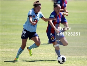 Battling my good friend Jodie Taylor for the ball